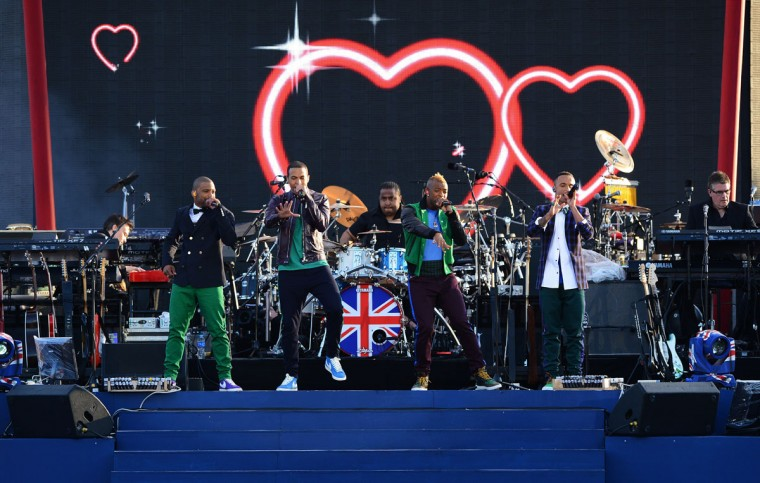 "British boy band JLS, Aston Merrygold, Oritse Williams, Jonathan Benjamin ""JB"" Gill and Marvin Humes perform during the Queen's Diamond Jubilee Concert at Buckingham Palace in London on June 4, 2012. (Leon Neal/AFP/Getty Images)"