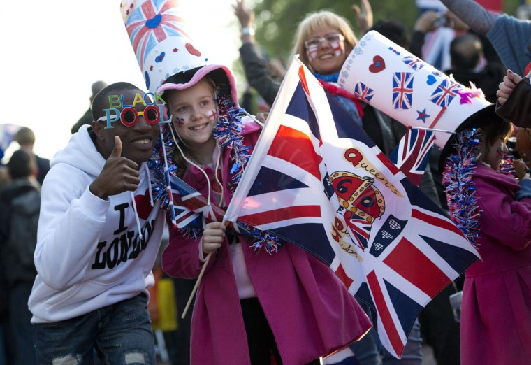 Children pose with Union Jack flags on the Mall outside Buckingham Palace in London, on June 4, 2012, during the Queen's Jubilee concert. (Miguel Medina/AFP/Getty Images)