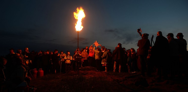 A diamond Jubilee beacon is lit at Mow Cop Castle near Kidsgrove in central England, on June 4, 2012. A chain of more than 4,200 beacons began to flare across the globe Monday to mark Queen Elizabeth II's diamond jubilee, with the last to be lit by the monarch at a star-studded concert at Buckingham Palace. (Andrew Yates/AFP/Getty Images)