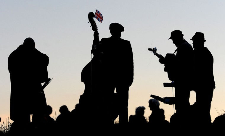 A band plays whilst waiting for the diamond jubilee beacon to be lit at Mow Cop Castle near Kidsgrove in central England on June 4, 2012. A chain of more than 4,200 beacons began to flare across the globe Monday to mark Queen Elizabeth II's diamond jubilee, with the last to be lit by the monarch at a star-studded concert at Buckingham Palace. (Andrew Yates/AFP/Getty Images)