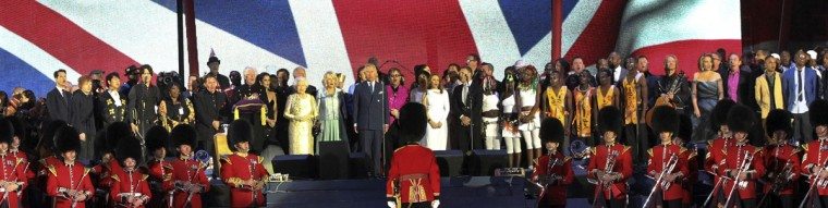 Queen Elizabeth II (C) is joined on stage by Prince Charles, Prince of Wales, and Camilla, Duchess of Cornwall, and performers during the Diamond Jubilee Concert outside Buckingham Palace in London, on June 4, 20112. (Arthur Edwards/AFP/Getty Images)