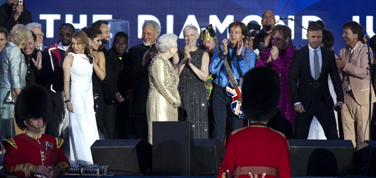 Queen Elizabeth II (C) is joined by singer Australian Kylie Minogue (5thL), British singer Sir Tom Jones (9thL), Dame Shirley Bassey, Sir Paul McCartney, Sir Elton John (3rdR) and Sir Cliff Richard (R)during the Diamond Jubilee Concert outside Buckingham Palace in London, on June 4, 20112. (David Parker/AFP/Getty Images)