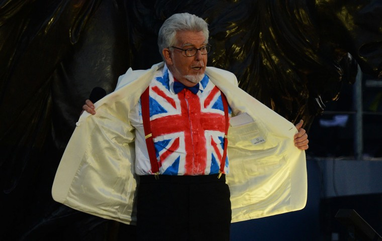 Australian artist Rolf Harris shows off his Union Flag shirt on stage during the Queen's Diamond Jubilee Concert at Buckingham Palace in London on June 4, 2012. (Leon Neal/AFP/Getty Images)