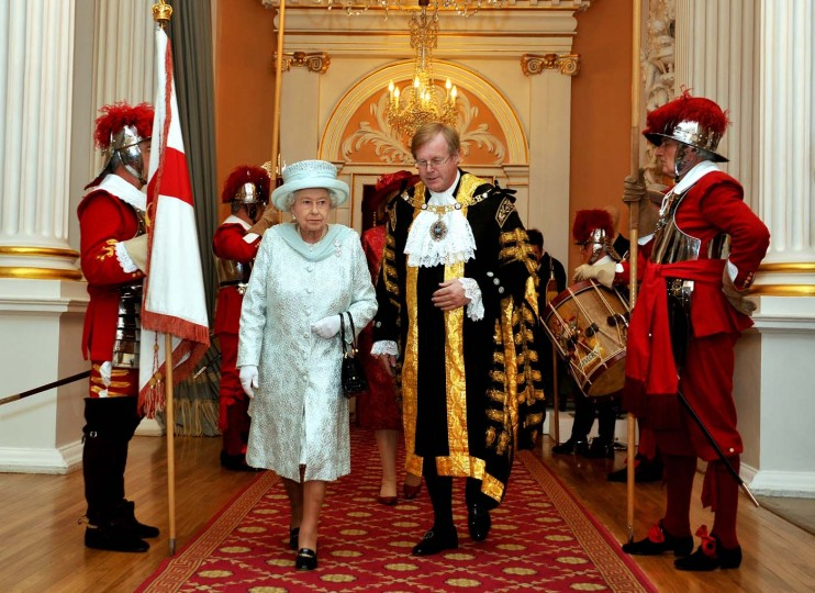 Britain's Queen Elizabeth II walks with David Wooton the Lord Mayor of London, after arriving at Mansion House in London, in honour of her Diamond Jubilee, on June 5, 2012. (John Stillwell/AFP/Getty Images)