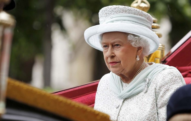 Queen Elizabeth II travels by carriage to Buckingham Palace after a lunch at Westminster Hall during the Diamond Jubilee carriage procession in London on June 5, 2012. (Peter Byrn/AFP/Getty Images)