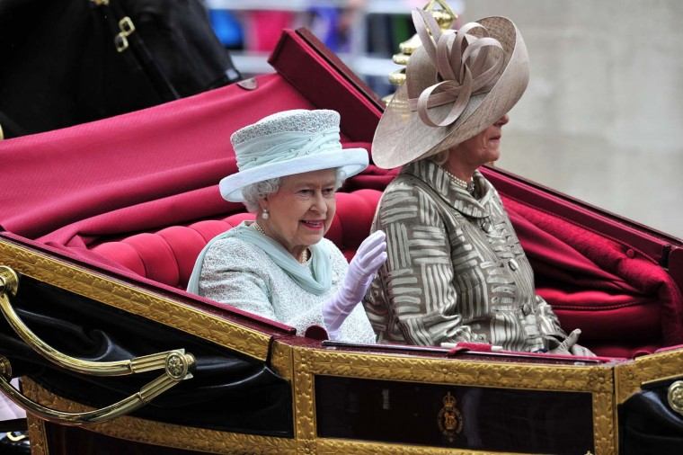 Britain's Queen Elizabeth II waves from her seat in the 1902 State Landau coach next to Camilla, Duchess of Cornwall, during the carriage procession from Westminster Hall to Buckingham Palace to celebrate the Queen's Diamond Jubilee in London on June 5, 2012. (Glyn Kirk/AFP/Getty Images)