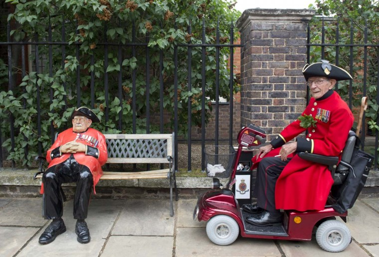 A Chelsea Pensioner, a British veteren soldier, rides a mobility scooter during the annual Founder's Day Parade at the Roya
