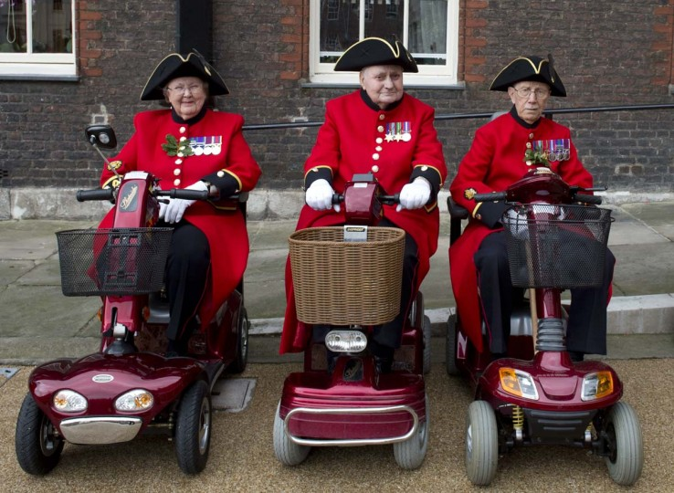 Chelsea Pensioners, British veteren soldiers, sit on mobility scooters during the annual Founder's Day Parade at the Royal Chelsea Hospital in London. (Miguel Medina/Getty Images)
