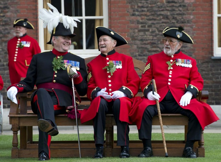 Chelsea Pensioners, British veteren soldiers, sit during the annual Founder's Day Parade at the Royal Chelsea Hospital. (Miguel Medina/Getty Images)