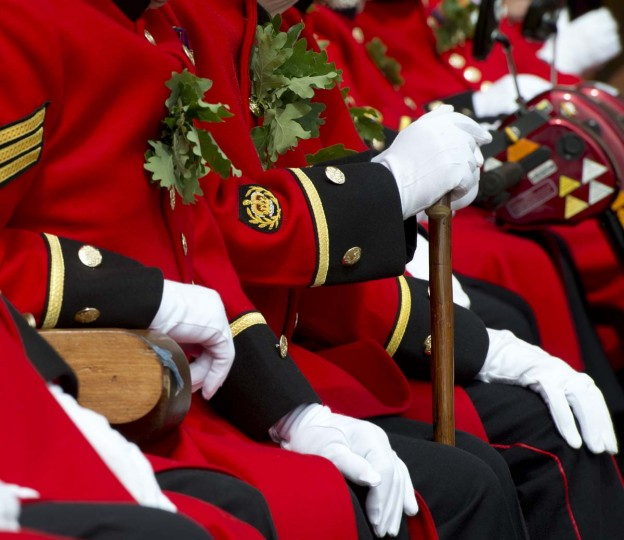 Chelsea Pensioners, British veteren soldiers, sit wearing their oak leaf sprigs during the annual Founder's Day Parade at the Royal Chelsea Hospital. (Miguel Medina/Getty Images)