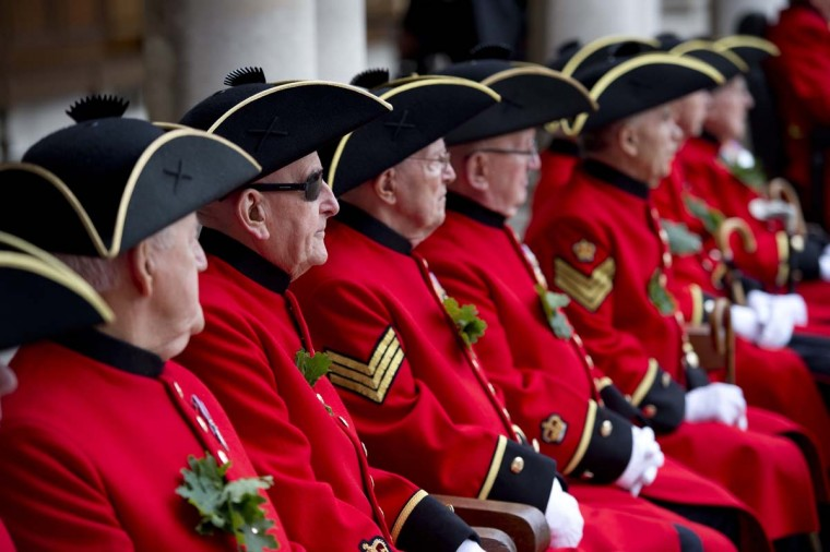 Chelsea Pensioners, all British veteren soldiers, sit during the annual Founder's Day Parade at the Royal Chelsea Hospital in London. (Miguel Medina/Getty Images)