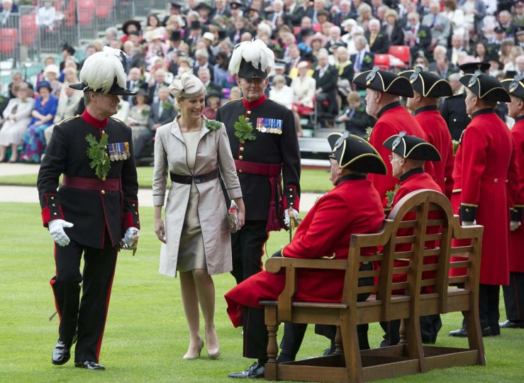 Sophie, Countess of Wessex, second from left, talks with a Chelsea Pensioner, a British veteren soldier, as she inspects during the annual Founder's Day Parade at the Royal Chelsea Hospital in London. (Miguel Medina/Getty Images)
