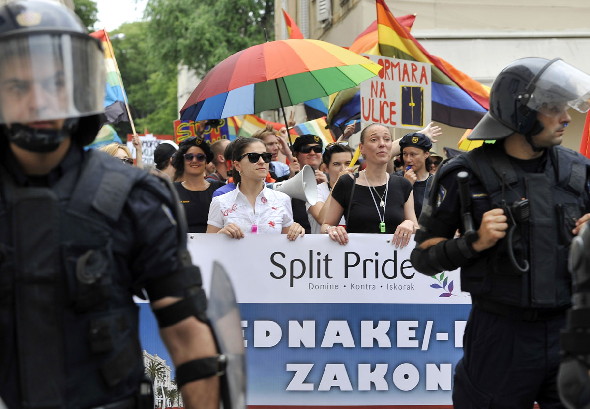 Split: Gay Pride activists wave rainbow flags as they participate in a Gay rights march on the eastern shores of Croatia on June 9, 2012. More than 300 people -- many carrying rainbow flags, a symbol of gay activism -- marched through the city while some 900 riot police secured the parade. (Hrvoje POLAN/AFP/Getty Images)