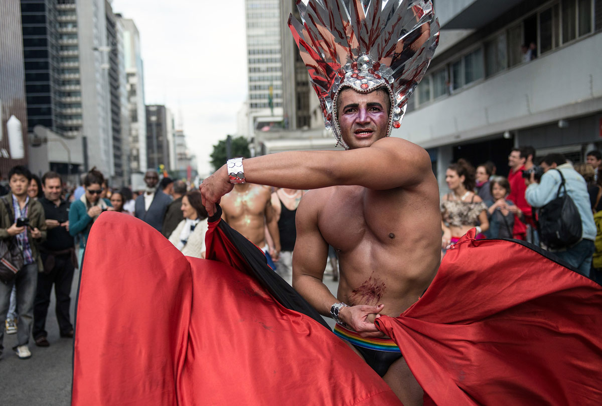 """Sao Paulo: Revelers enjoy the annual Gay Pride Parade on June 10, 2012. About 3 million people were expected to take part in the parade under the 2012 theme """"Homophobia has cure."""" (Yasuyoshi Chiba/AFP/Getty Images)"""