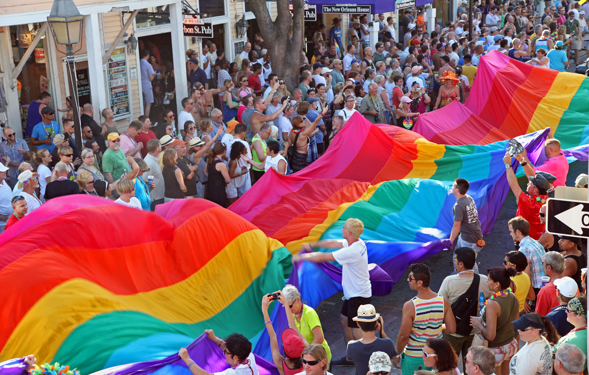 Florida Keys: Revelers carry a 100-foot-long rainbow flag, a symbol of gay pride, down Duval Street in Key West, Florida on June 10, 2012, as a facet of a parade to mark the end of the five-day Key West Pride festival that celebrates the subtropical island's acceptance and diversity. (Carol Tedesco/AFP PHOTO/Florida Keys News Bureau)