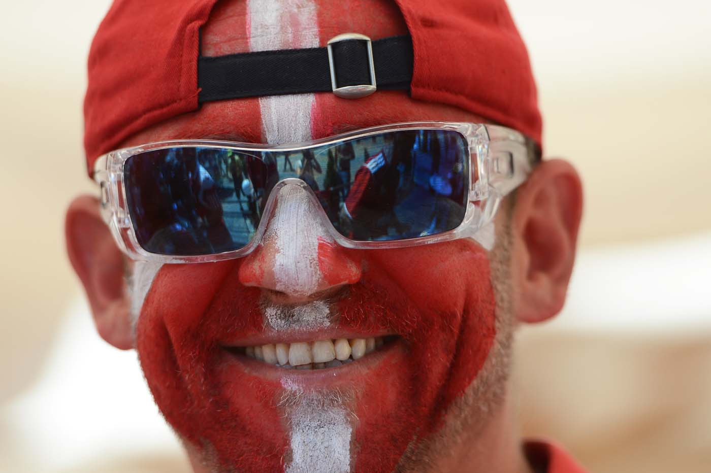 A Danish fan with his national flag painted on the face is pictured ahead of the Euro 2012 football championships match Denmark vs. Germany on June 17, 2012 in Lviv. (Anne-Christine Poujoulat/AFP/Getty Images)