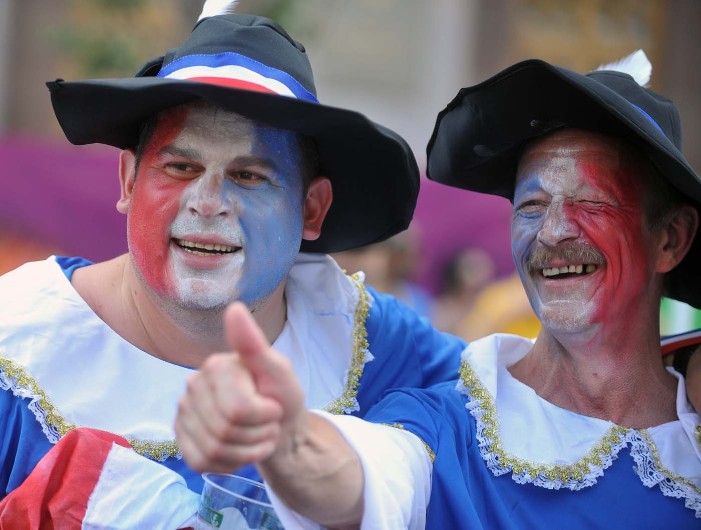 France supporters pose on June 19, 2012 at the fanzone in Kiev, ahead of the Euro 2012 football championships match Sweden vs. France. (Genya Savilovgenya/AFP/Getty Images)