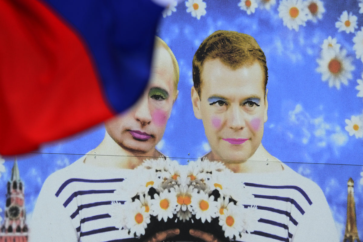 Berlin: A poster featuring Russia's President Vladimir Putin and Russia's Prime Minister Dmitry Medvedev is displayed during protests against Russia's policies on homosexuality during the annual Christopher Street Day (CSD) parade on June 23, 2012. Gays and lesbians all around the world are celebrating the Christopher Street Day gay and lesbian pride parade, arguably the most important date in their calendar. (John MacDougall/AFP/Getty Images)
