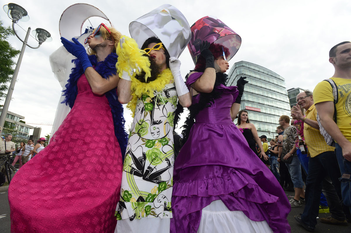 Berlin: Participants dance during the annual Christopher Street Day (CSD) parade on June 23, 2012. Gays and lesbians all around the world are celebrating the Christopher Street Day gay and lesbian pride parade, arguably the most important date in their calendar. (John MacDougall/AFP/Getty Images)