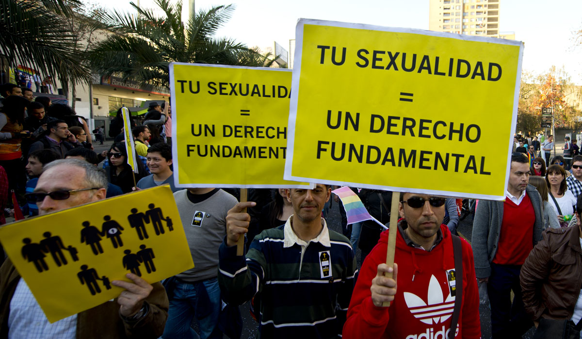 """Santiago: People hold signs reading """"Your sexuality = A fundamental right"""" as they take part in a demonstration for a law for equal rights of the gay, lesbian and transsexual community on June 23, 2012. (Martin Bernetti/AFP/Getty Images)"""