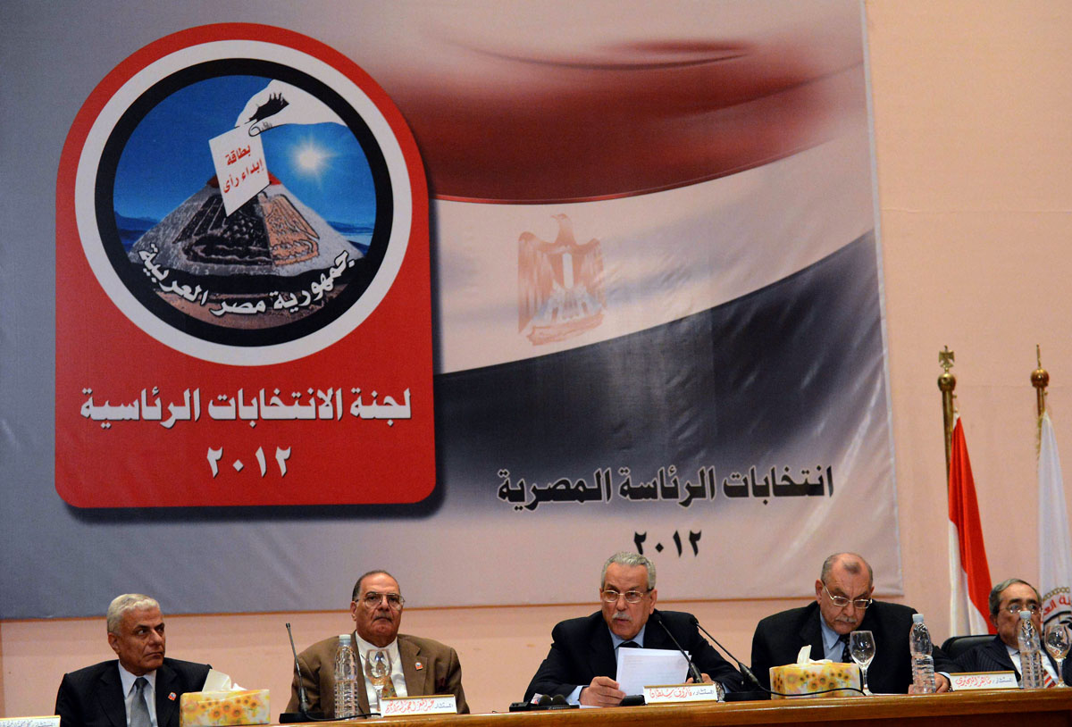 June 24, 2012: Faruq Sultan (3rd L), head of the elections presidential committee, speaks during a televised press conference where he announced the winner of the Egyptian presidential elections in Cairo. The Muslim Brotherhood's Mohamed Morsi was declared the winner and new president of Egypt, beating Ahmed Shafiq, the former prime minister under ousted president Hosni Mubarak. (Khaled Desouki/AFP/Getty Images)