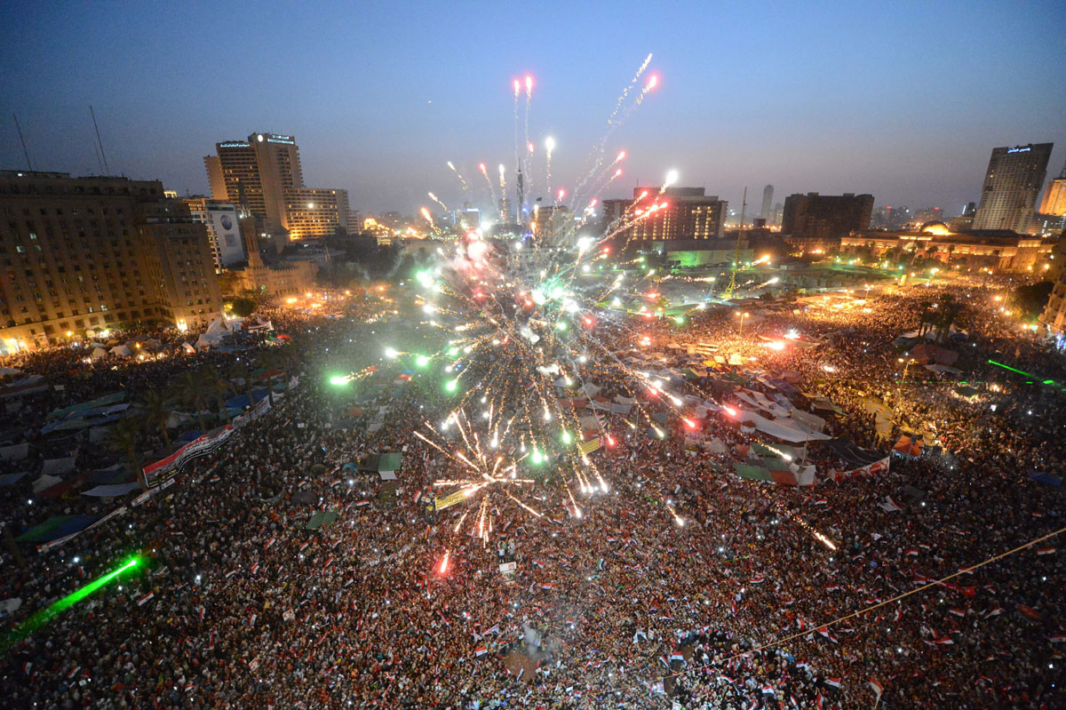 June 24, 2012: Egyptians set off fireworks in Cairo'€™s Tahrir Square as they celebrate the victory of the Muslim Brotherhood's candidate, Mohamed Morsi, in Egypt's presidential elections. Tens of thousands packed into Tahrir Square in the largest celebration the protest hub has witnessed since Hosni Mubarak's ouster, to celebrate their new president-elect, Morsi. (Khaled Desouki/AFP/Getty Images)