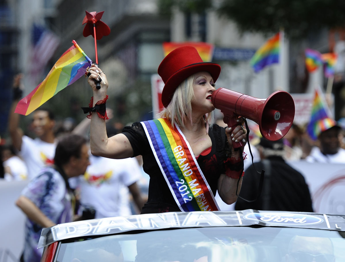 New York: Grand Marshall Cyndi Lauper rides down 5th Avenue during the 2012 New York City's Gay Pride on June 24, 2012. The 43rd-annual parade with more than 500,000 people is part of Gay Pride week. (Timothy A. Clary/AFP/Getty Images)
