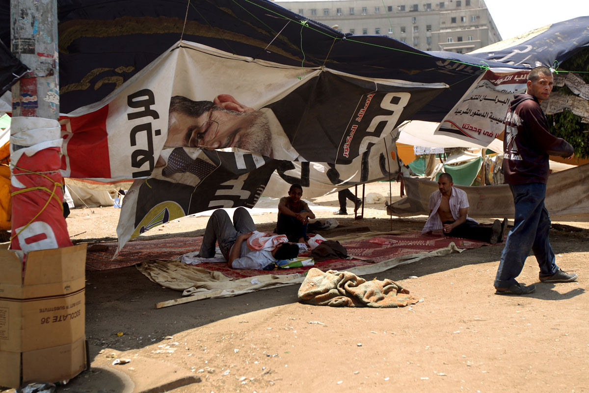 "June 25, 2012: Egyptian supporters of the country's new president-elect, Muslim Brotherhood leader Mohamed Morsi, rest under the shade in Cairo's Tahrir Square, one day after Morsi was elected as Egypt's ""first civilian president"". Morsi pledged to be a leader for all Egyptians after being crowned successor to ousted strongman Hosni Mubarak in a triumph for the long-repressed Islamist movement. (Marwan Naamani/AFP/Getty Images)"