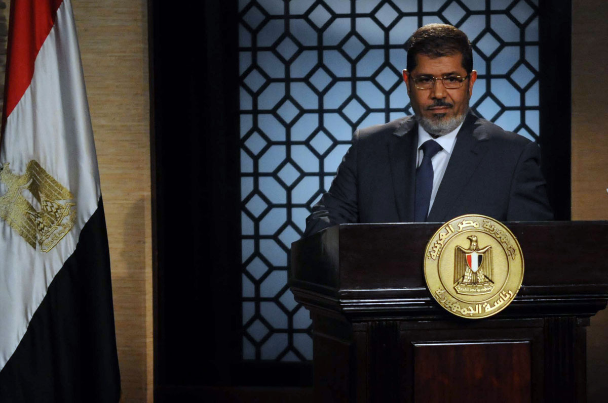 June 24, 2012: Egypt's new president-elect, Muslim Brotherhood leader Mohamed Morsi, gives a speech in the studio of the state television in Cairo after winning the Egyptian presidential elections. Morsi, the country's first elected leader since a popular uprising ousted president Hosni Mubarak, won 51.73 percent of the vote against ex-premier Ahmed Shafiq. (STR/AFP/Getty Images)