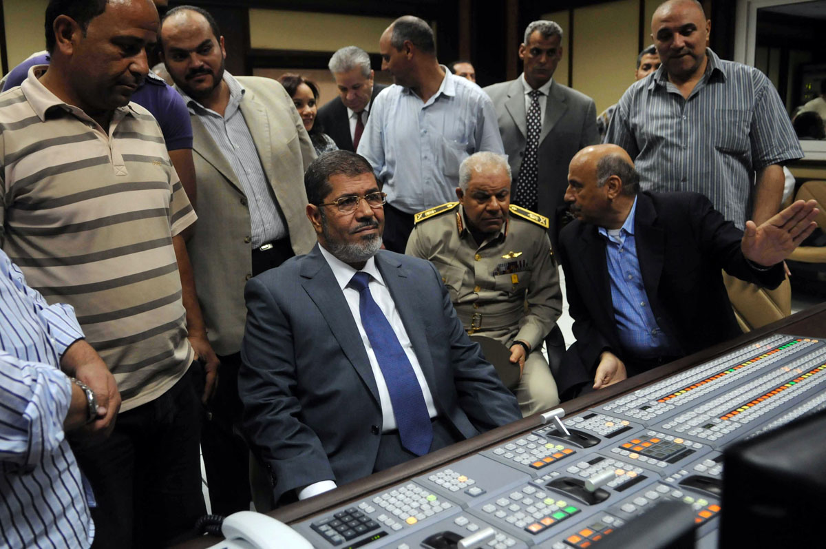 June 24, 2012: Egypt's new president-elect, Muslim Brotherhood leader Mohamed Morsi (C), sits in the studio of the state television in Cairo after recording a speech to the nation after winning the Egyptian presidential elections. Morsi, the country's first elected leader since a popular uprising ousted president Hosni Mubarak, won 51.73 percent of the vote against ex-premier Ahmed Shafiq. (STR/AFP/Getty Images)