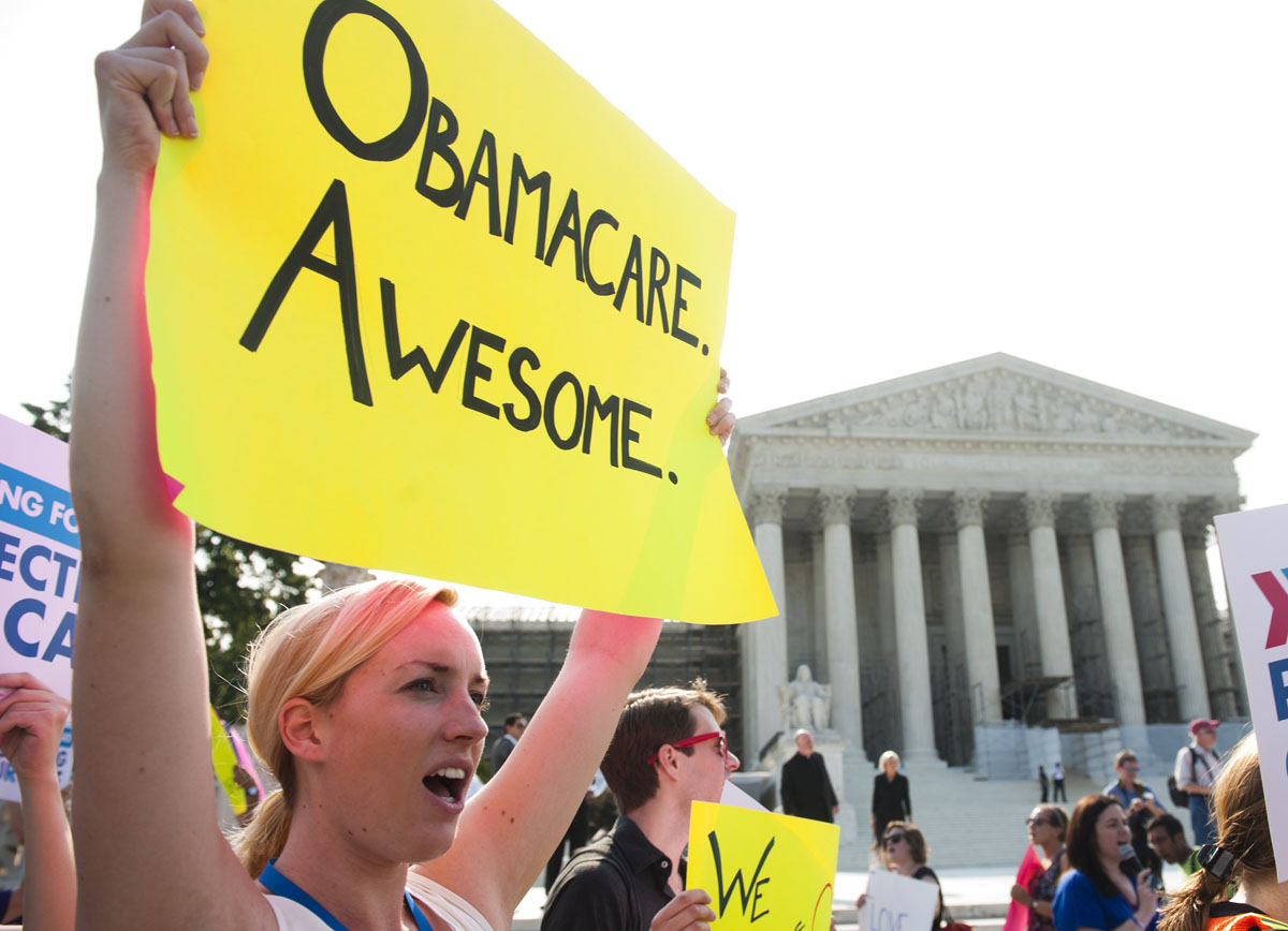 June 28, 2012: Demonstrators in favor of US President Barack Obama's signature healthcare legislation await a decision by the US Supreme Court on the constitutionality of the Affordable Healthcare Act, outside the Supreme Court in Washington, DC, June 28, 2012. (Saul Loeb/AFP/Getty Images)