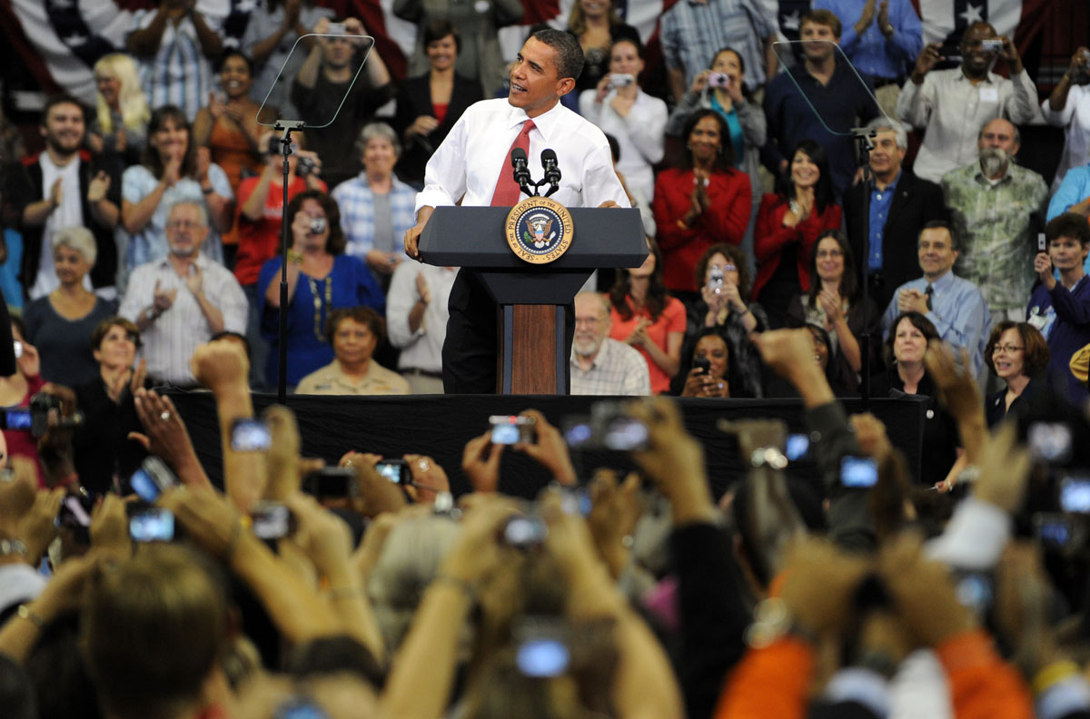 September 17, 2009: US President Barack Obama speaks during a rally on healthcare at the Comcast Center in College Park, Maryland, on September 17, 2009. Thousands of people turned out Thursday, some waiting for hours from before sunrise, to hear President Barack Obama speak about his proposed health care reforms. (Jewel Samad/AFP/Getty Images)