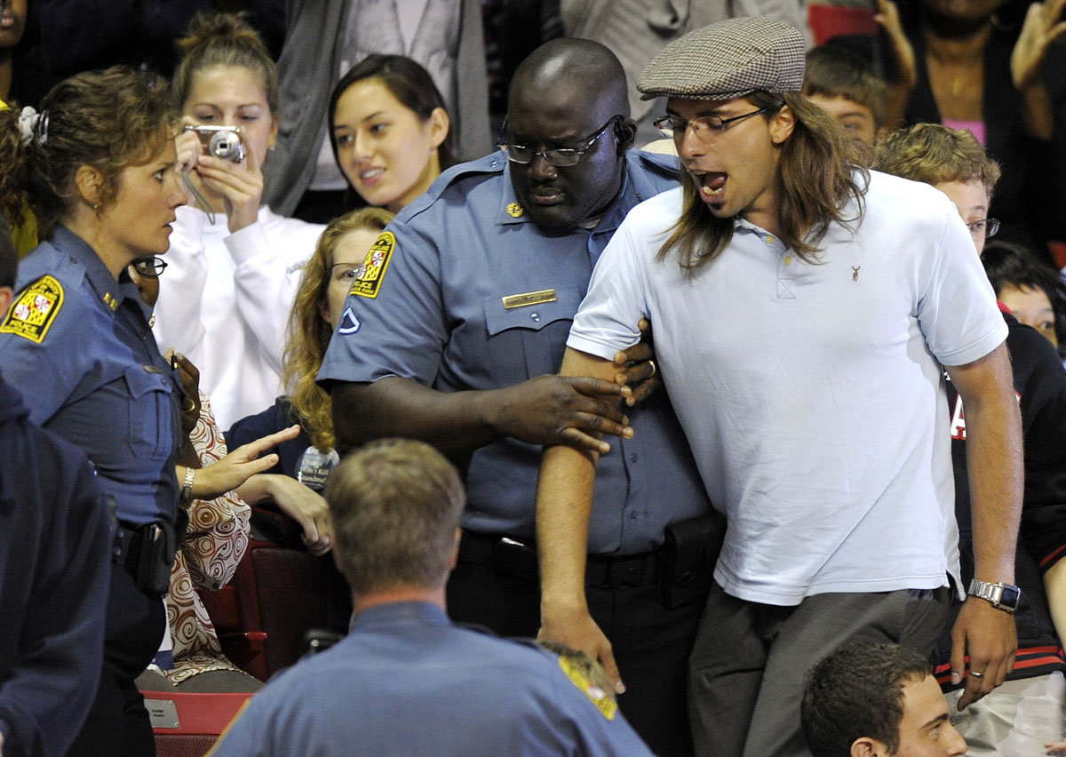 September 17, 2009: Security personnel escort a man after he shouted against US President Barack Obama's healthcare reform while Obama spoke during a rally on healthcare at the Comcast Center in College Park, Maryland, on September 17, 2009. Thousands of people turned out Thursday, some waiting for hours from before sunrise, to hear President Barack Obama speak about his proposed health care reforms. (Jewel Samad/AFP/Getty Images)