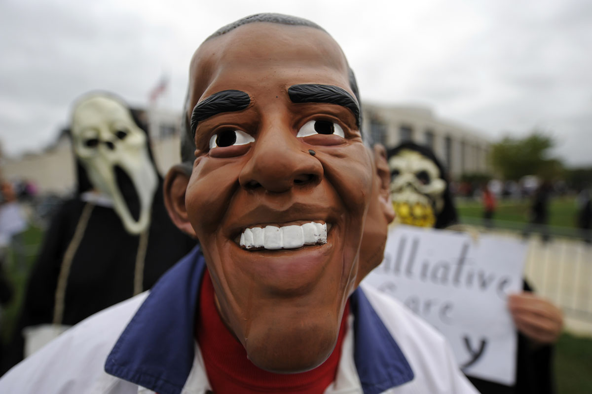 September 17, 2009: Protesters against US President Barack Obama's healthcare reform stage an act outside the Comcast Center where Obama will hold a rally on healthcare in Colleage Park, Maryland, on September 17, 2009. (Jewel Samad/AFP/Getty Images)