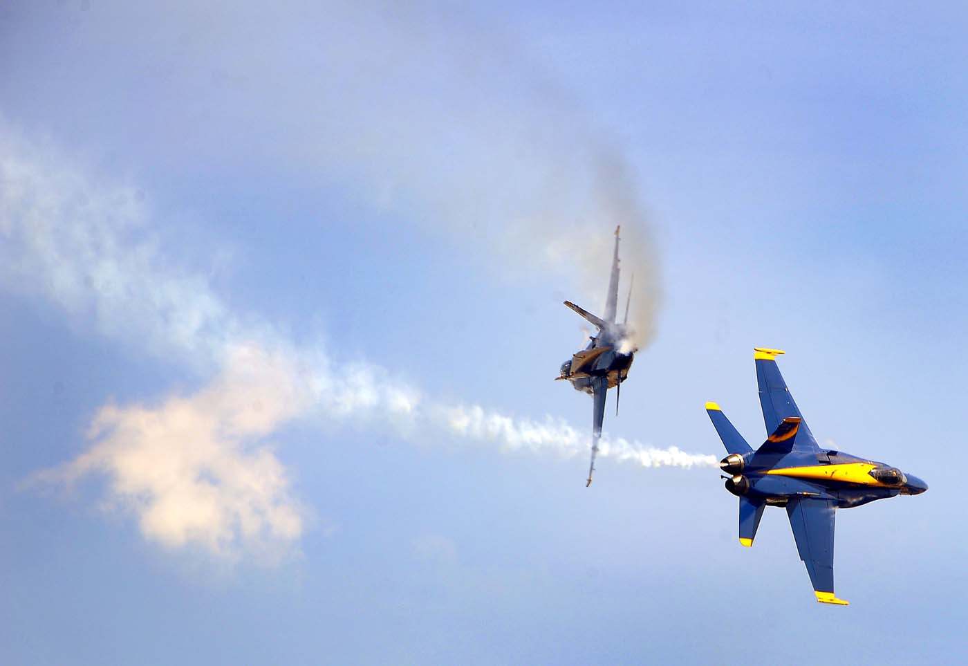 Two Blue Angels - Boeing F/A-18 Super Hornet planes - break away from each other, participating in the air show during the weekend-long Star Spangled Sailabration 200 at Fort McHenry Saturday, Jun 16, 2012. (Karl Merton Ferron/Baltimore Sun)