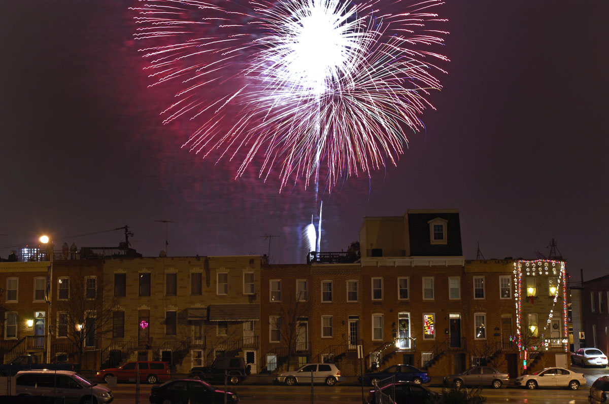 The 2007 New Years fireworks are seen from Fort Avenue. Nikon D2Xs, ISO 100, f8 at 3 seconds. (Karl Merton Ferron / The Baltimore Sun)
