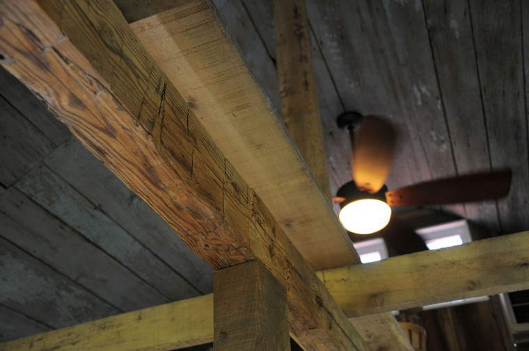 May 16, 2012: A recycled pine beam that once was part of a barn built in the 1700's, which withstood the War of 1812, is now used as part of the structure of the store at Serenity Farm, near the Patuxent River, where once British troops gathered during the War of 1812. (Karl Merton Ferron/Baltimore Sun)