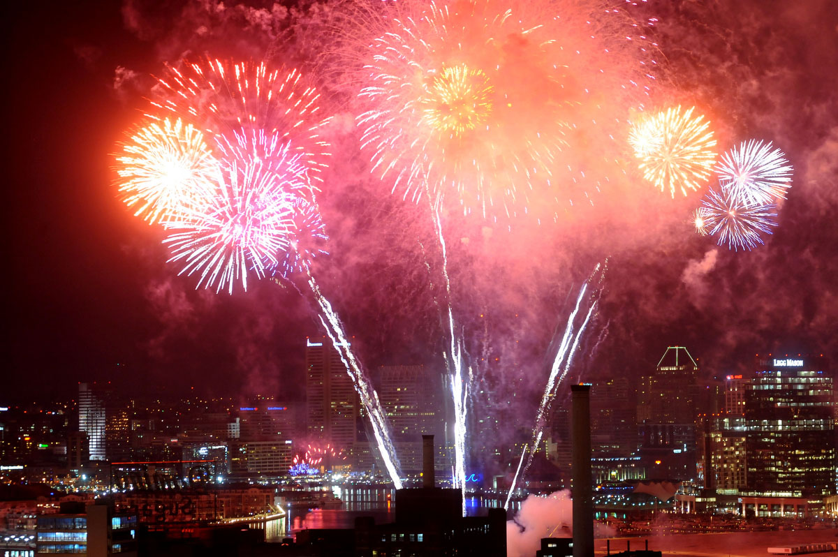 Baltimore rings in 2012 with New Year's Eve fireworks over the inner harbor as seen from Silo Point. Photographed with a Nikon D3 at ISO 2000, f5.6 at 1/6 second. (Jerry Jackson / Baltimore Sun)