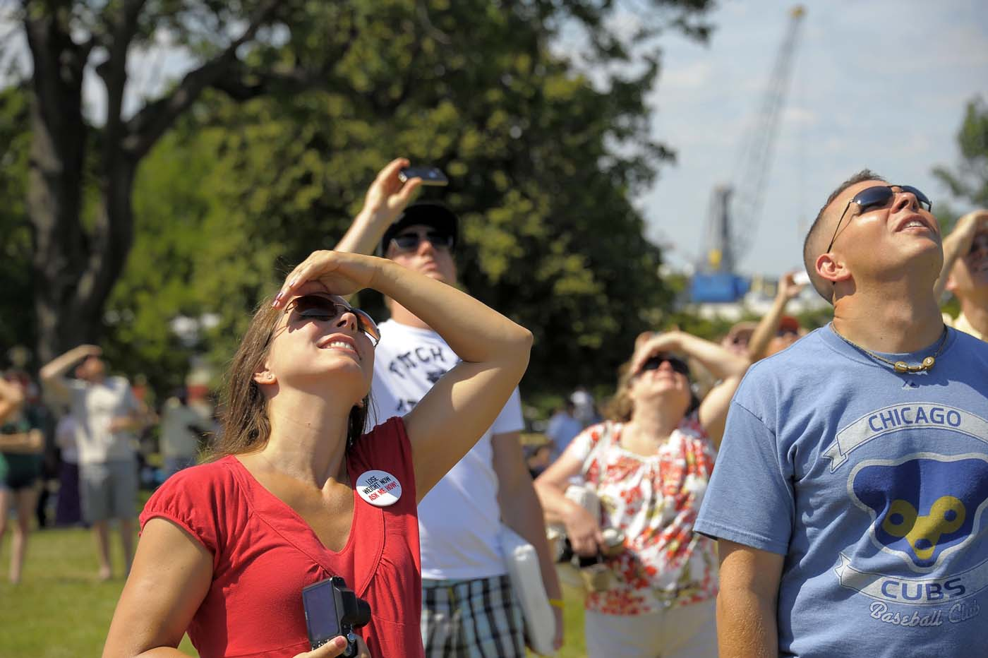 Spectators watch the skies for the Blue Angels during the weekend-long Star Spangled Sailabration 200 at Fort McHenry Saturday, Jun 16, 2012. (Karl Merton Ferron/Baltimore Sun)