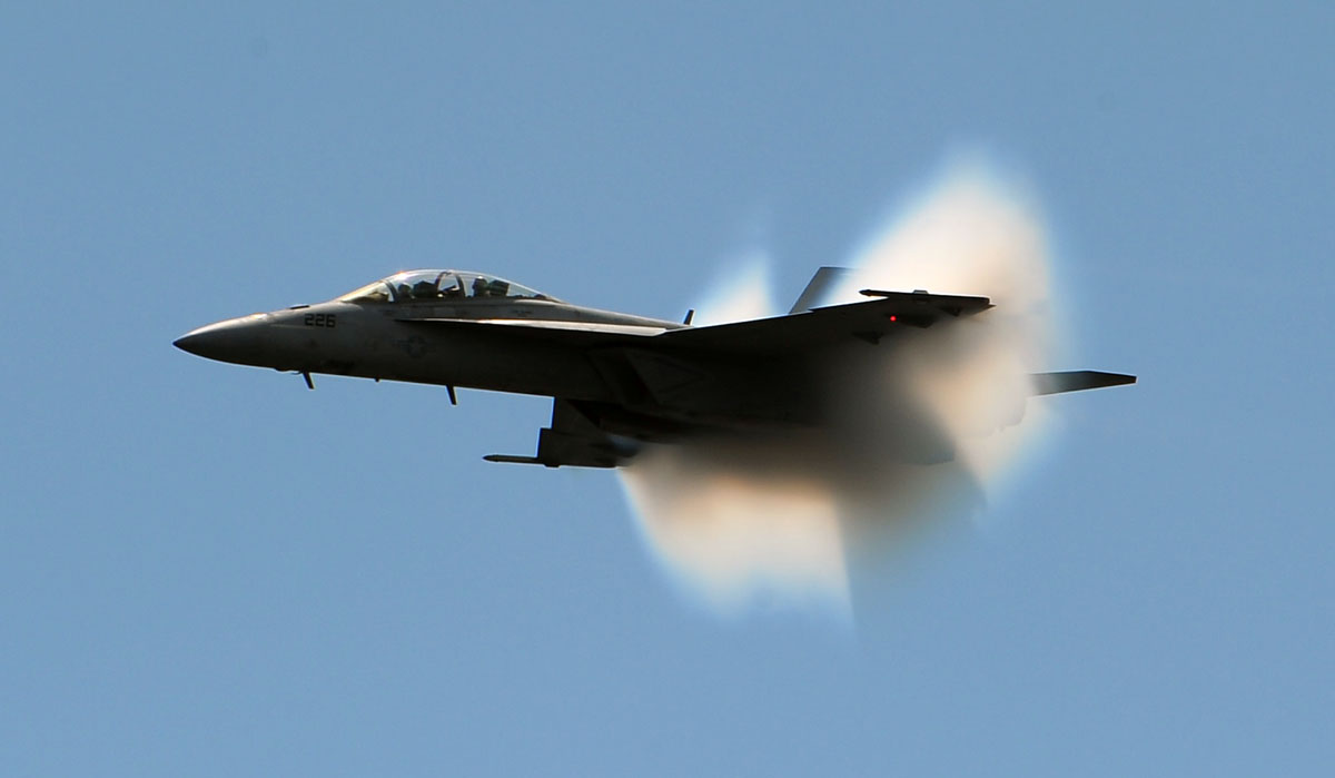 A F18 Super Hornet breaks the sound barrier during Friday practice for the air show over Fort McHenry. The cloud is the air particles being compressed as the jet approaches the speed of sound. (Gene Sweeney Jr./Sun Photographer)