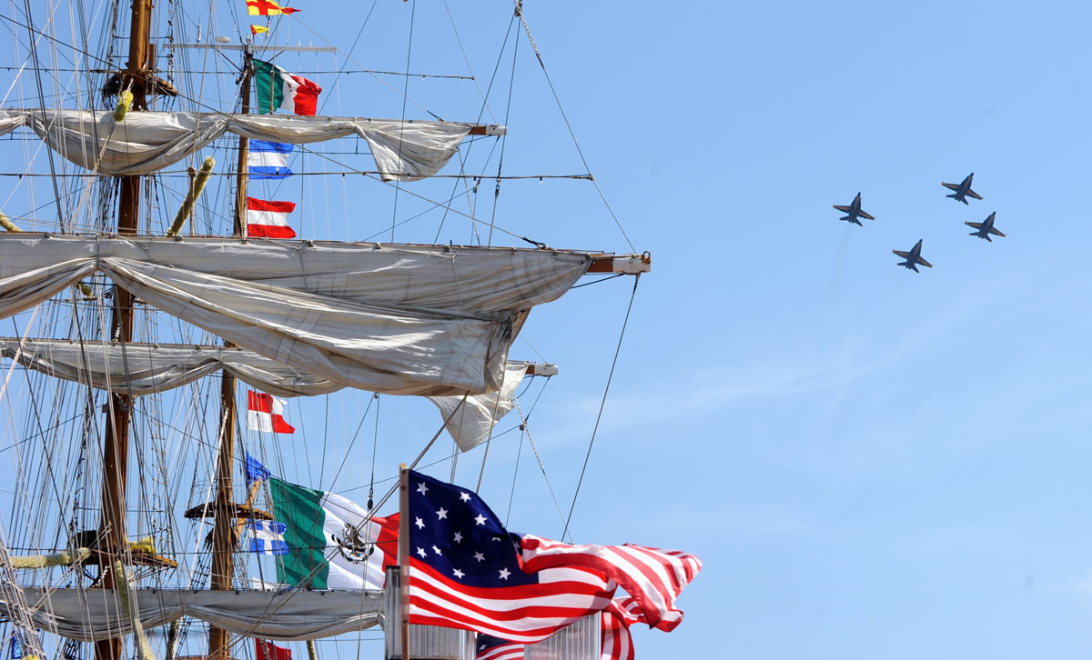 The Blue Angels fly in formation over the Inner Harbor next to the ARM Cuauhtemoc from Mexico as the Sailabration sails into Sunday June 17, 2012. (Algerina Perna/Baltimore Sun)