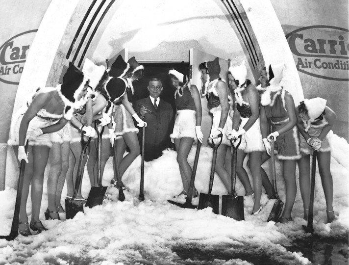 "Willis Carrier, ""Father of air conditioning:"" – Carrier's ""Igloo of Tomorrow"" opened April 25, 1939 in 90 degree heat with scantily clad ""snow bunnies"" scooping manufactured slush under the benevolent supervision of thermometer-wielding company founder Willis Haviland Carrier. (Courtesy of the Smithsonian Institution/AP Photo)"