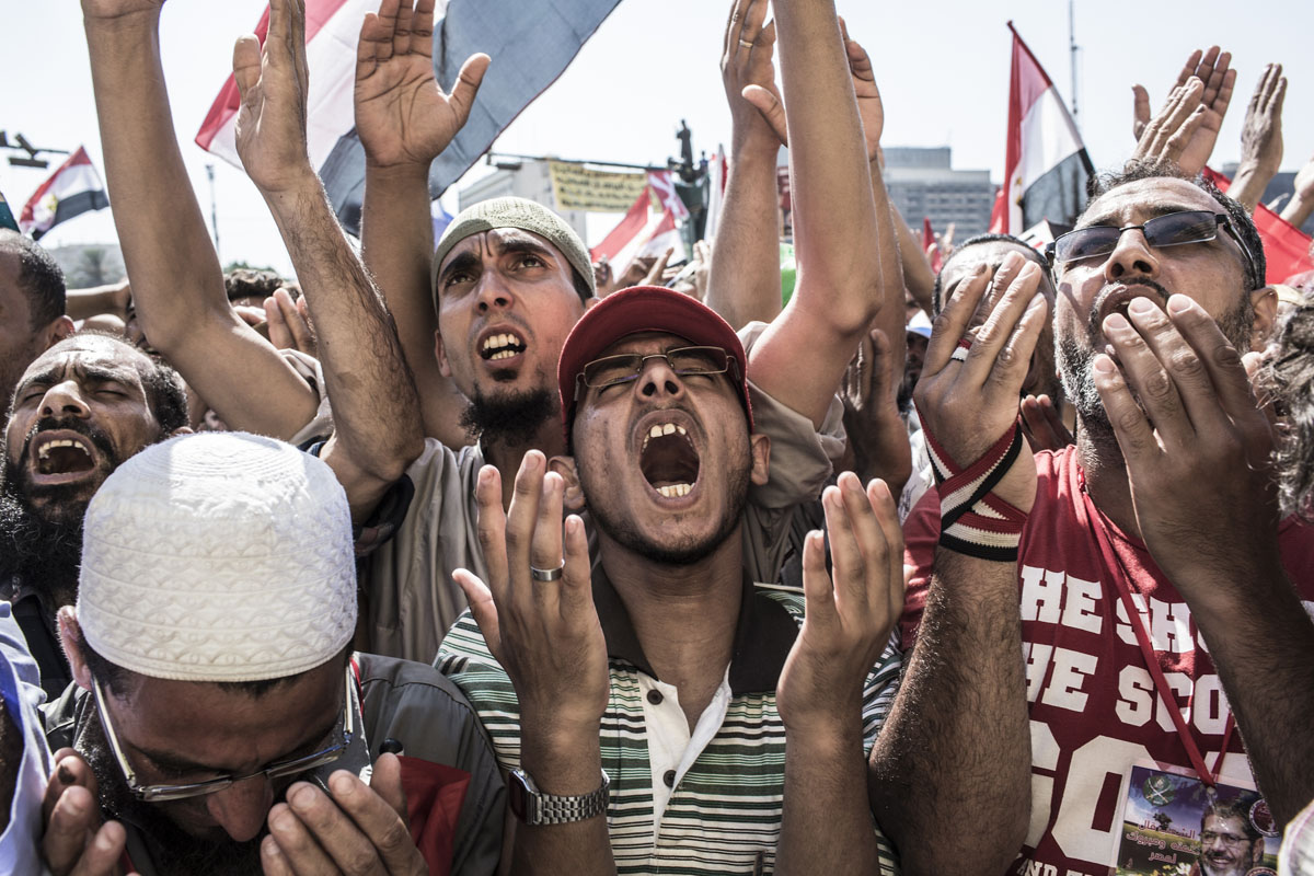 June 24, 2012: Egyptians pray as they celebrate the election of their new president Mohamad Morsi in Tahrir Square in Cairo, Egypt. Official election results today confirmed that Mohamed Morsi is to be the next president of Egypt. Morsi received over 13 million or 51.7% of the votes, while his main rival, former Prime Minister Ahmed Shafiq, received 48.27 percent. (Daniel Berehulak/Getty Images)