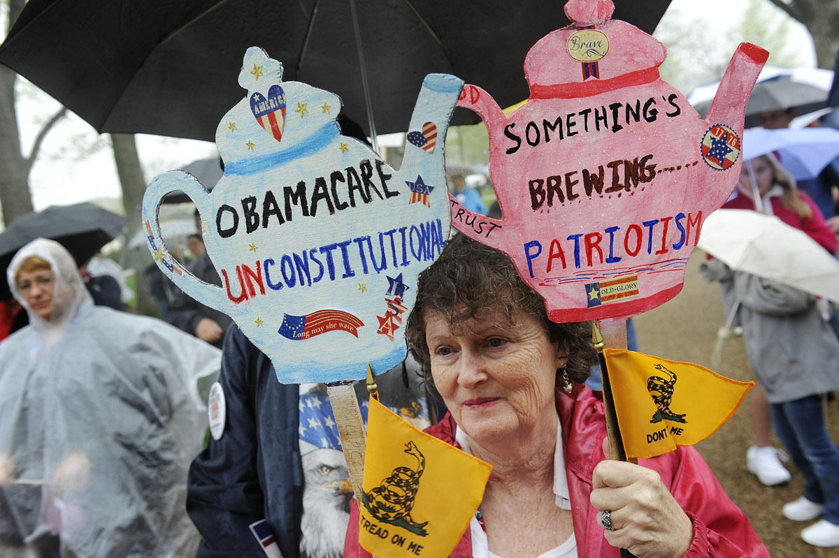 March 24, 2012: People hold signs at a Tea Party Patriots rally calling for the repeal of the 2010 healthcare law championed by President Barack Obama, on Capitol Hill in Washington, March 24, 2012. The Supreme Court will hear arguments next Monday to Wednesday over the fate of Obama's healthcare law, a battle with legal, political and financial implications for the U.S. healthcare system's biggest overhaul in nearly 50 years. (Jonathan Ernst/Reuters)