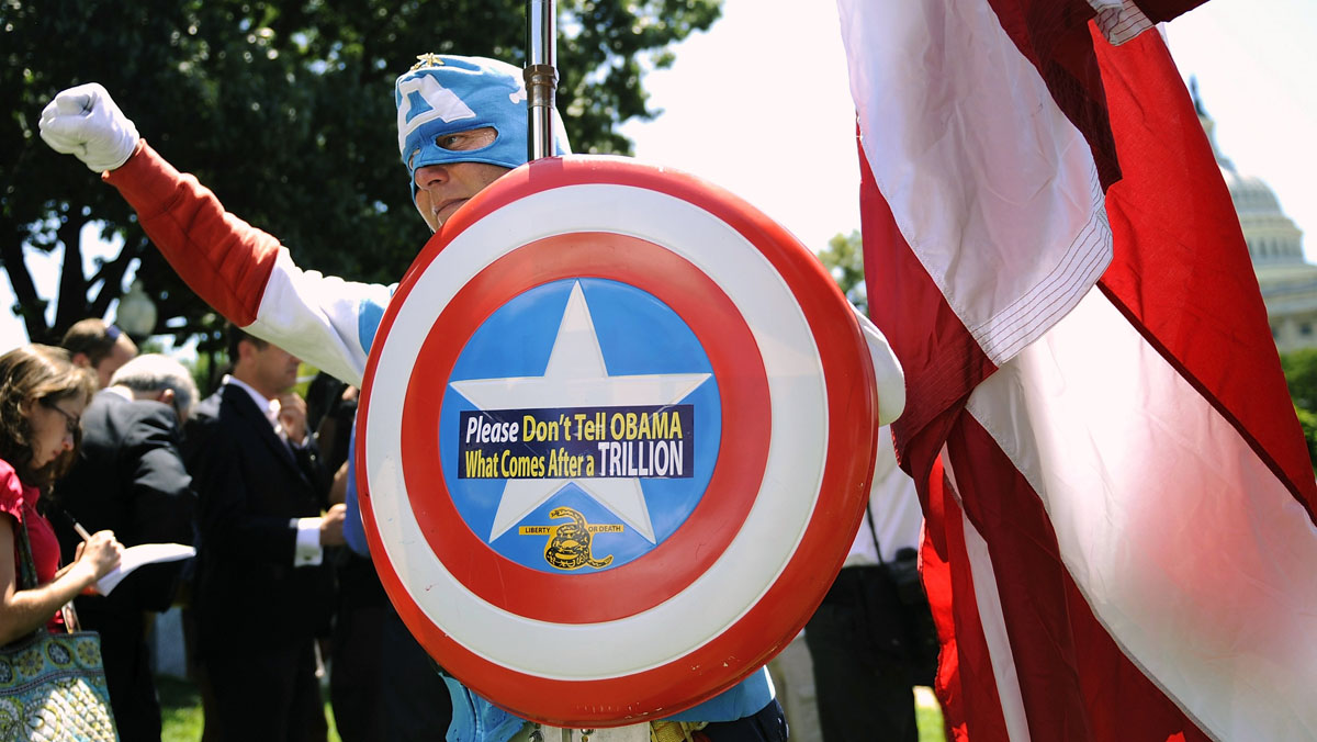 July 27, 2011: A man dressed as Captain America poses as dozens of Tea Party supporters rally near the U.S. Capitol against raising the debt limit in this July 27, 2011. Tea Party supporters now hold fewer sign-waving rallies, a hallmark of their early opposition to bank bailouts and U.S. President Barack Obama's healthcare reform in 2009. But the movement isn't losing steam. (Jonathan Ernst/Reuters)