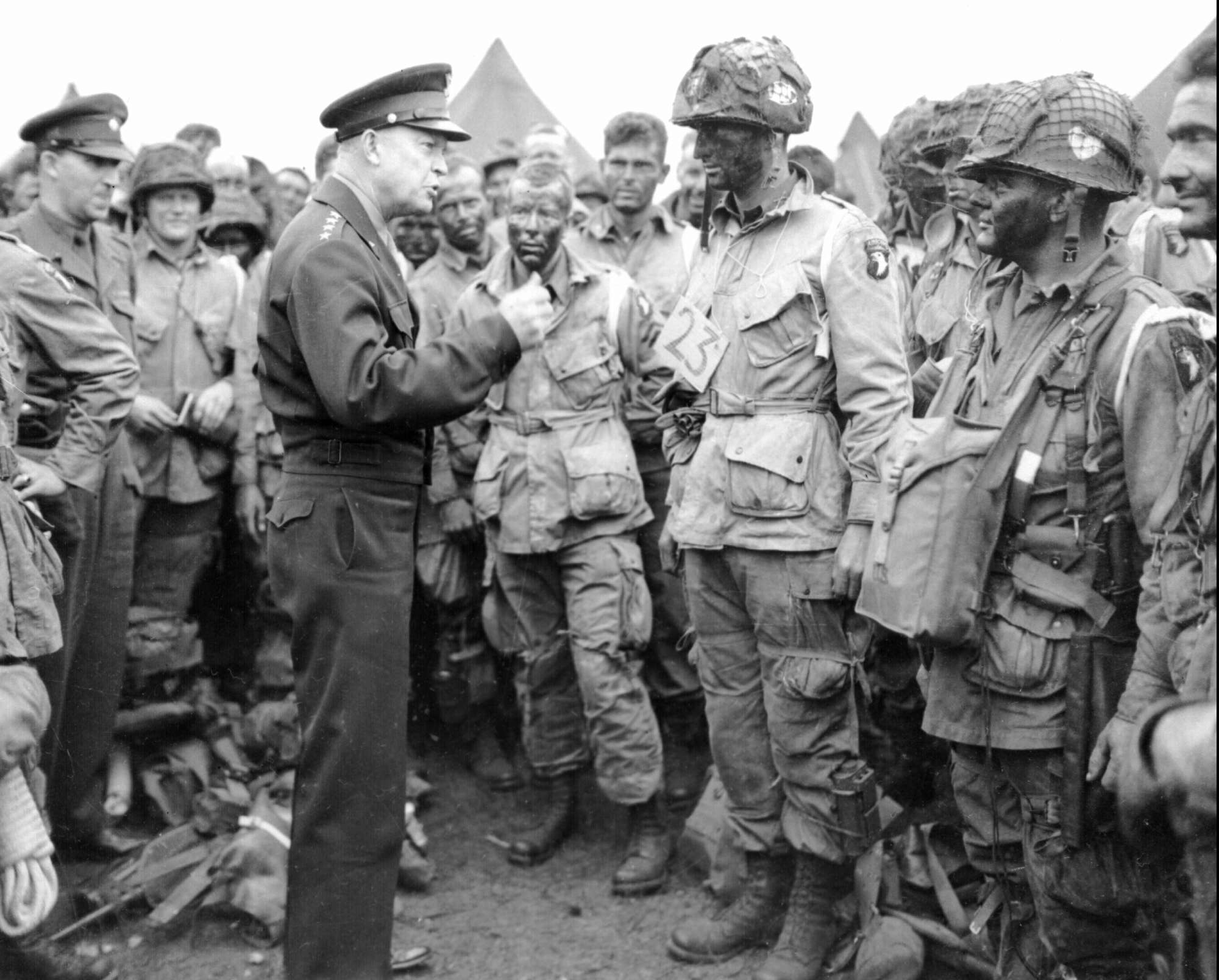 Gen. Dwight D. Eisenhower visits paratroopers on June 5, 1944, moments before the troops boarded transport planes bound for Normandy and the June 6 D-Day invasion. This photo became a pre-invasion classic. (AP Photo/File)