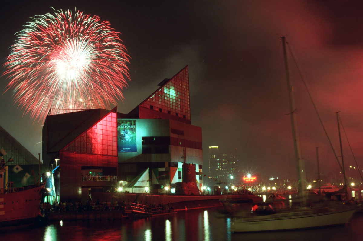 Fireworks explode over the Inner Harbor and The National Aquarium in Baltimore on The Fourth of July, 2000. The view is from next to the World Trade Center. (Steve Ruark / The Baltimore Sun)
