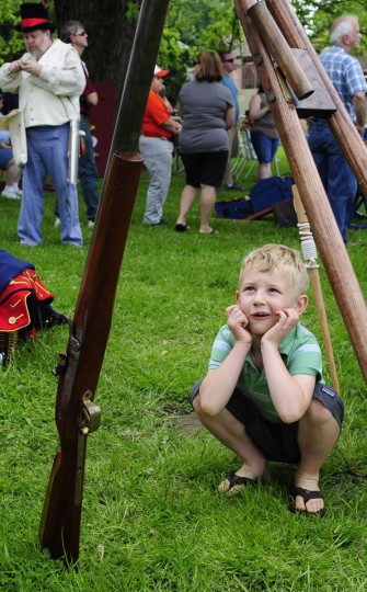 May 5, 2012: Wyatt Whitin admires the Amussette, or Wall gun during his visit to a War of 1812 re-enactment at the Lock House Museum in Havre de Grace. (Matt Button/Aegis)