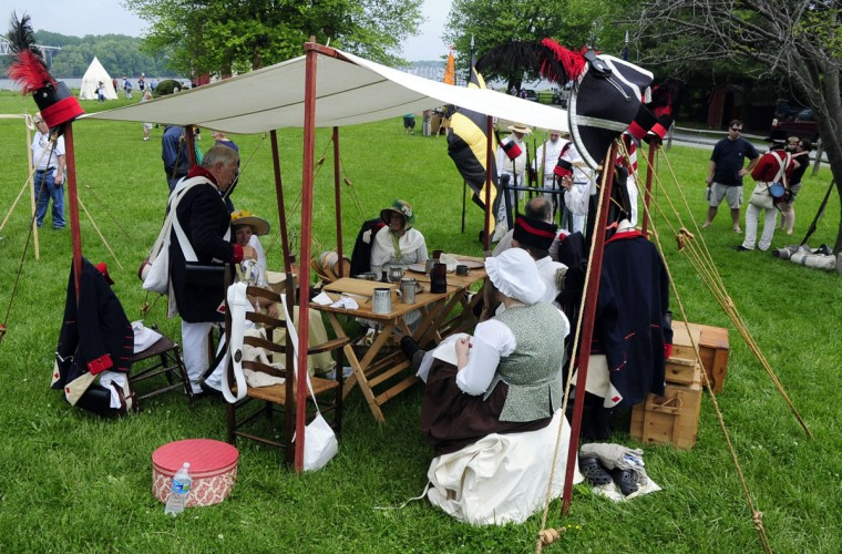 May 5, 2012: Re-enacters take a break after their firing drills for the crowd during a War of 1812 re-enactment at the Lock House Museum in Havre de Grace. (Matt Button/Aegis)