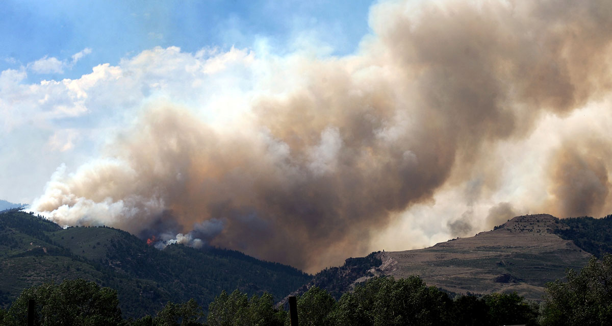 JUNE 26: The Waldo Canyon Fire creeps down the north facing hill of the canyon's trailhead toward U.S. Highway 24 Tuesday, June 26, 2012, near Colorado Springs, Colorado. (Christian Murdock/Colorado Springs Gazette/MCT)